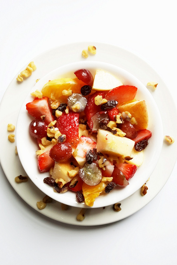 This summery fruit salad gets a boost from delicious and nutrient-dense walnuts!